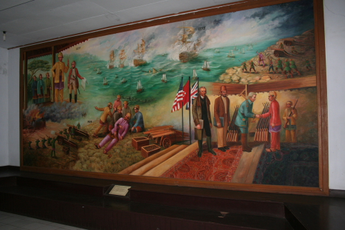 One of the many colorful murals found in the museum. This one depicts Sultan Thaha purchasing arms, his opposition to the Dutch, and finally his death.