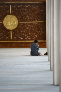 A Man Praying in Mesjid Agung