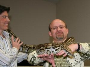 C. & P. Holding a Python