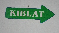 """Kiblat"" means orientation, or direction. This word, with it's corresponding arrow points in the direction of the City of Mecca, the direction Muslims face while praying."