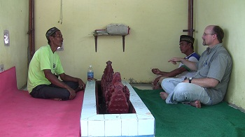 Chet speaking with men who were praying at the Grave of Putri Ayu.