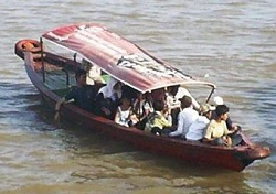 A ketek is a common form of transportation along Jambi rivers. This one is being used to transport people (river taxi).