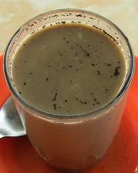 Kopi Susu after stirring.Most of the coffee grounds will sink to the bottom.