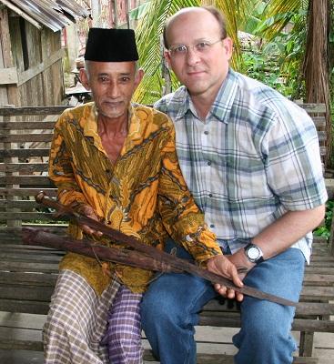 Pak (Mr.) Abdulah, showing C. his magic sword.