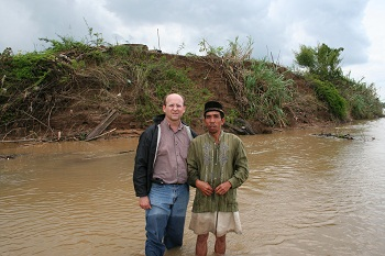 Chet with the local man who took him to the Island of Island of Penaga in his boat.