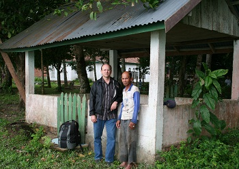 C. & Pak (Mr.) Paipai in front of the grave of Moyang Suduto.