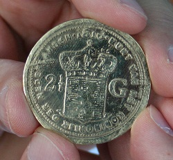 Replica of an old Dutch coin, which many Indonesians believe possesses magical powers, after it has gone through a ritual with a shaman / witch doctor (dukun, orang pintar).