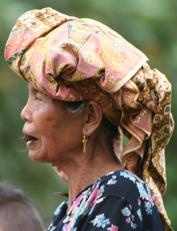 Batin woman with a traditional head covering, which they call a takuluk.