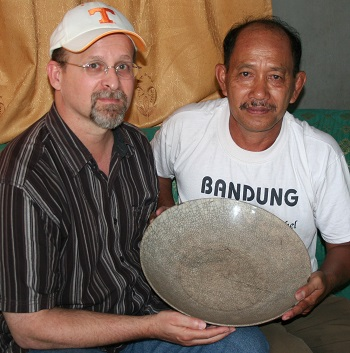 C. and Mr. Ansyori as they hold the dish said to have been used by the