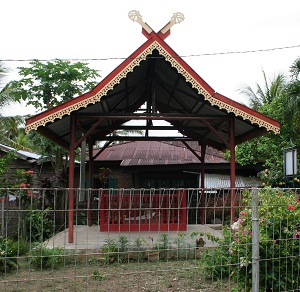 The Karang Berahi stone is maintained in a well-kept park with a roof over it, but tragically exposed to the elements.