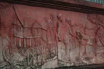 This is a relief at the base of the building below the tower.
