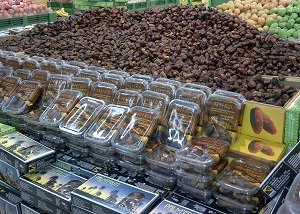Large display of dates in the Hypermart grocery store.